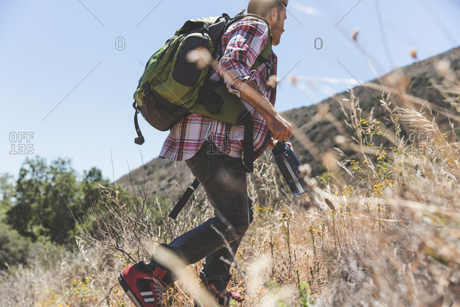 Young adult male hiking low angle view