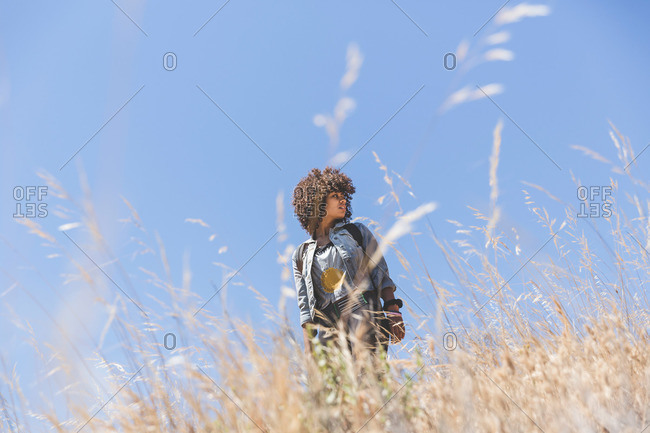 Young adult female hiker low angle view