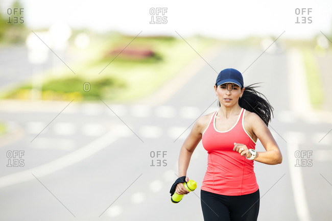 Close up of female jogger running