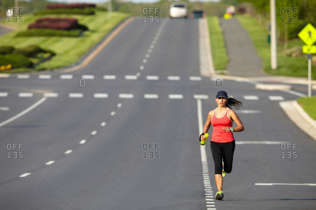 Female jogger running in the road