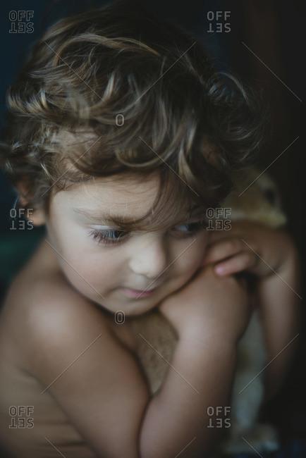 Little boy cuddling a pet bunny