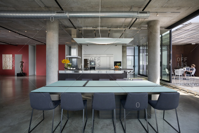 Minneapolis, MN, USA - June 24, 2010: Dining room and kitchen in modern loft home