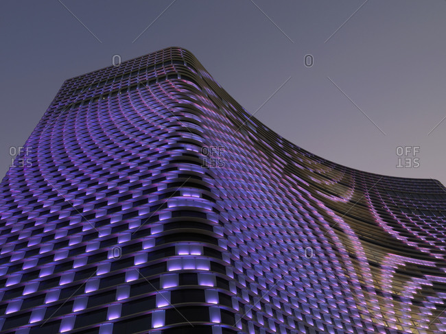 Kaohsiung, Taiwan - February 11, 2009: Low angle view of hotel with purple illumination
