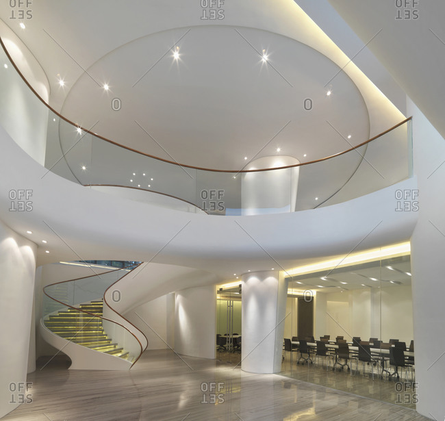 Xiamen, China - April 28, 2011: Interior of spacious foyer with spiral staircase in Chinese hospital