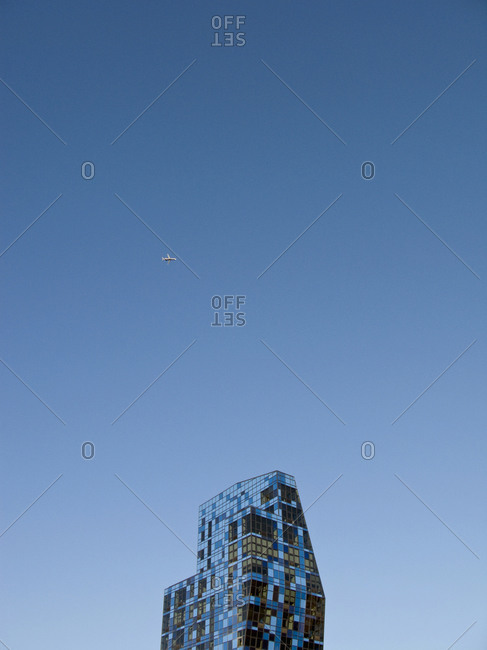 New York, NY,  USA - October 10, 2008: Plane flying above the Blue Tower by Bernard Tschumi in Lower East Side