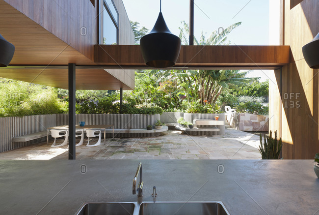 Bellevue Hill, Australia - April 13, 2011: Modern kitchen with open pocket doors to patio