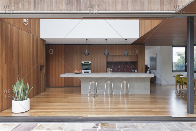 Bellevue Hill, Australia - February 25, 2011: Kitchen with open pocket doors to patio