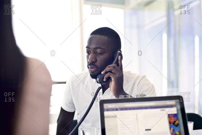 Young office worker on a call
