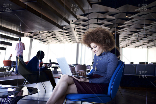 Young woman with a laptop in an office