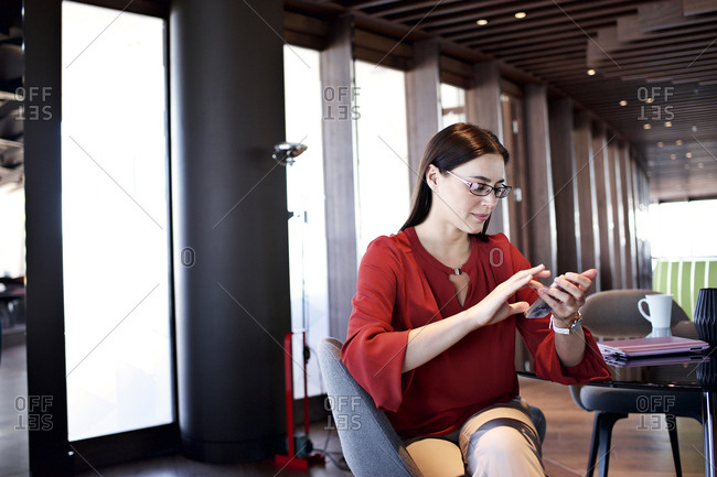 Office worker checking her smartphone