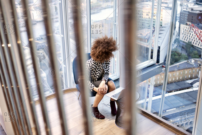 Office worker looking at view from office windows