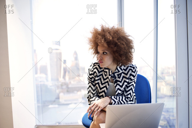 Young professional with a laptop in an office