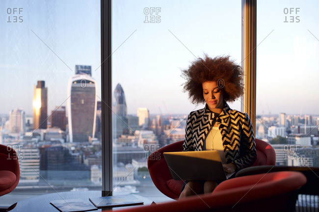 Office worker with city skyline in background