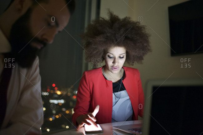Young urban professionals working late