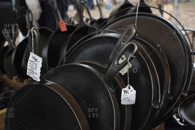 Rows of cast iron pans for sale