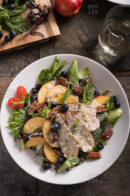 Salad with grilled chicken, nectarines, blueberries, pecans and cherry tomatoes