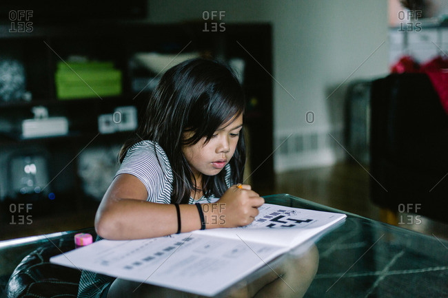 Young girl working on a crossword puzzle
