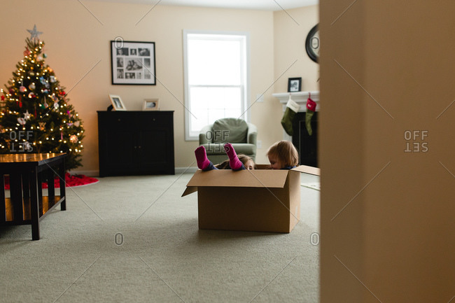 Girls playing in a cardboard box at Christmas time