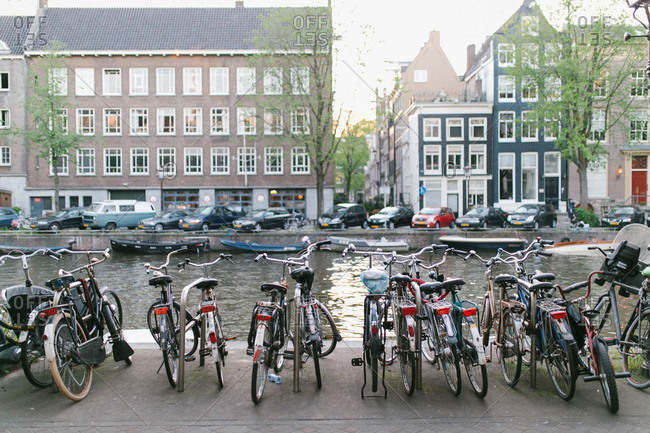 Bicycles parked along the Singel Canal, Grachtengordel canal district of Amsterdam, Netherlands