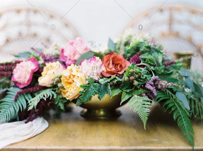 Flower arrangement in gold dish