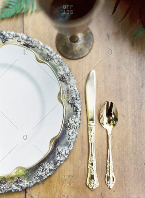 Table setting with gold and silver accents up close