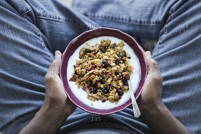 Man holding a bowl of spicy pumpkin granola