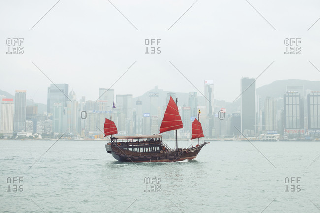 Traditional boat floating off the coast of Hong Kong, China