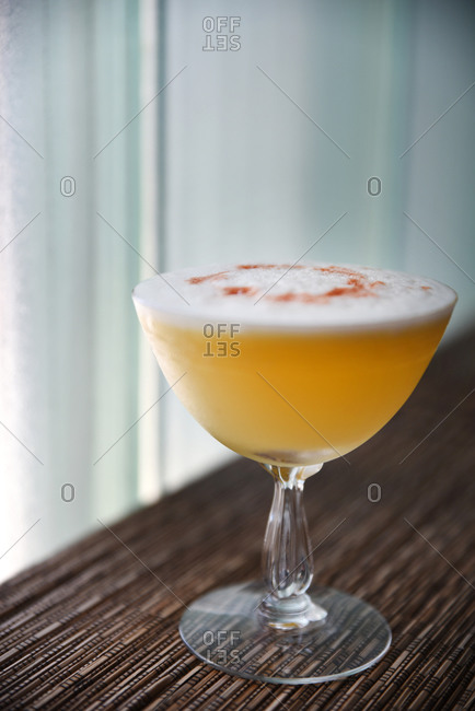A cocktail with foam on top