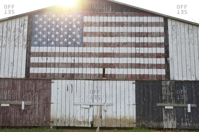American flag painted on side of a barn