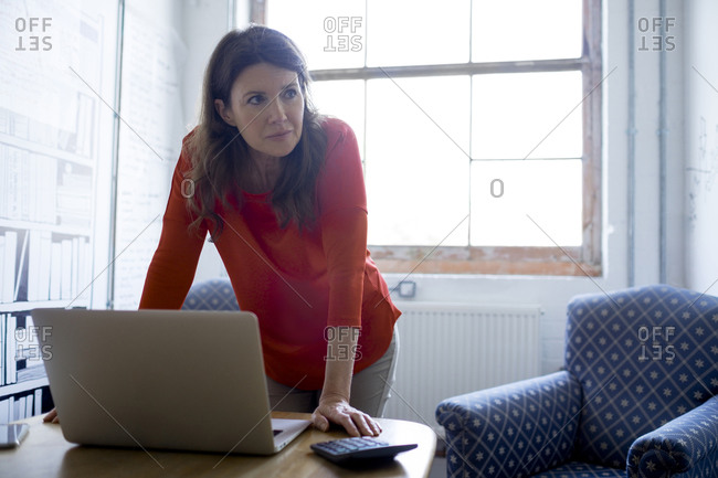 Businesswoman in an office with a laptop