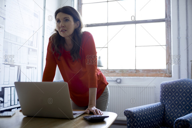Businesswoman with a laptop in an office