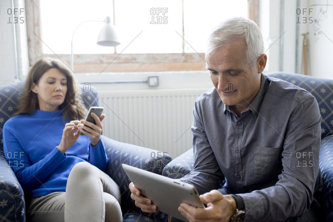 Business partners with tablet computer and smartphone
