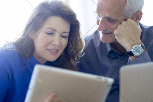 Couple looking at a smart tablet together
