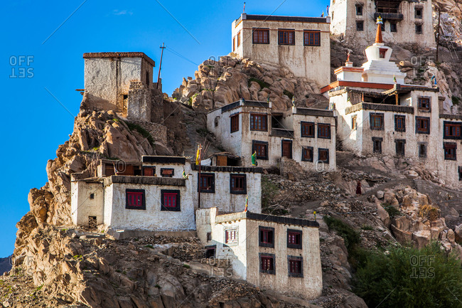 Houses and temple perched on a steep hillsides in Thiksey, Ladakh, India