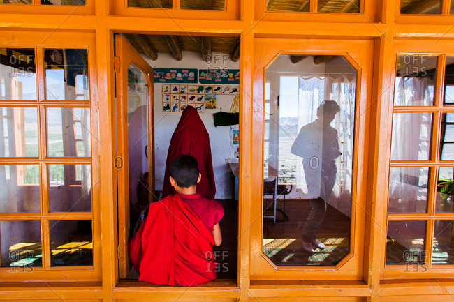 Thiksey, Ladakh, India - August 30, 2010: Young Buddhist monk studying in a classroom of Thiksey Gompa in Ladakh, India