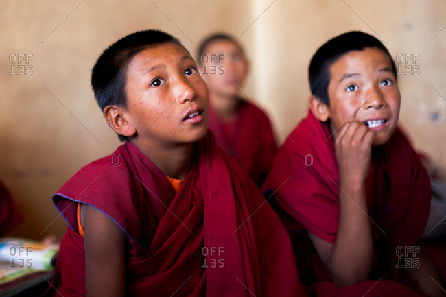 Thiksey, Ladakh, India - August 30, 2010: Three young monks listen closely to classroom lesson Thiksey Gompa in Ladakh