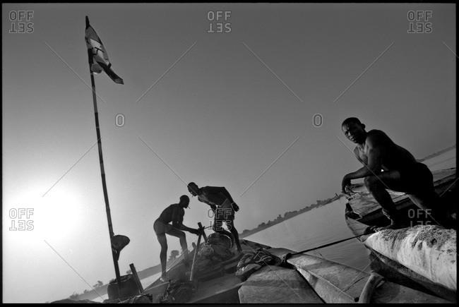 Bamako, Mali - June 8, 2011: Sand fishermen on their boats in Mali