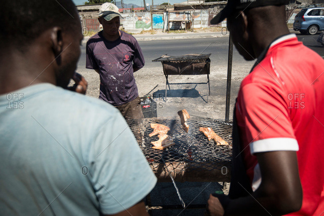 Cape Town, South Africa - February 17, 2015: Man making street food in Cape Town, South Africa