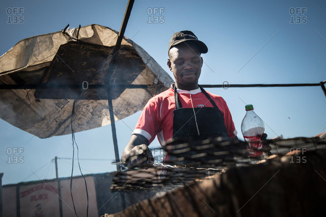 Cape Town, South Africa - February 17, 2015: A man making street food in Cape Town, South Africa