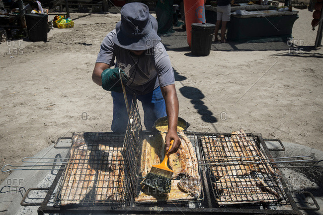 Man preparing seafood at restaurant in South Africa