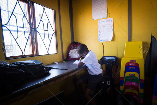 Cape Town, South Africa - February 17, 2015: Student writing in a school in South Africa