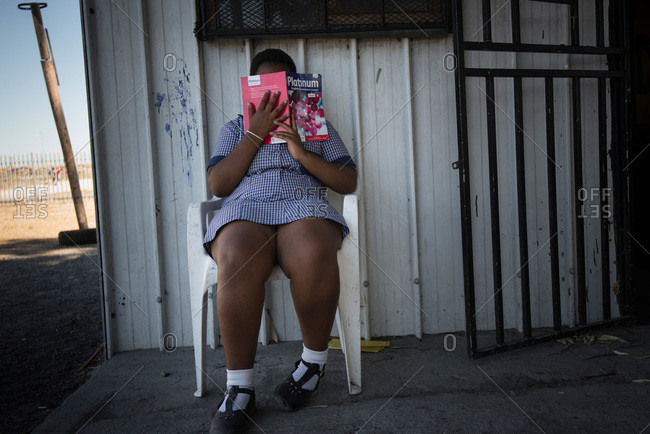 Cape Town, South Africa - February 17, 2015: Female student covering her face in South Africa