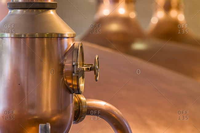 Details of a copper kettle used in the old industrial process of brewery