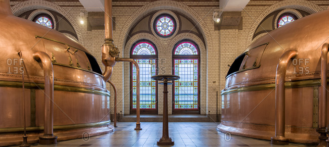 October 6, 2015: Stained glass windows and copper tanks inside historic brewery in Amsterdam