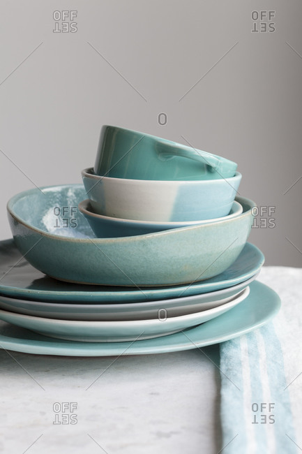 Modern blue dinnerware on kitchen table