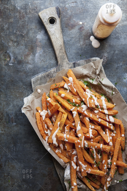 Sweet potato fries with parsley, sriracha hot sauce and mayonnaise