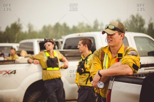Alberta, British Colombia, Canada - July 12, 2015: Panorama Crew Services members standing by trucks, Alberta, British Colombia, Canada