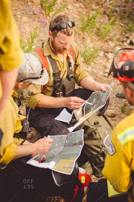 Alberta, British Colombia, Canada - July 12, 2015: Panorama Crew Services members reviewing maps, Alberta, British Colombia, Canada