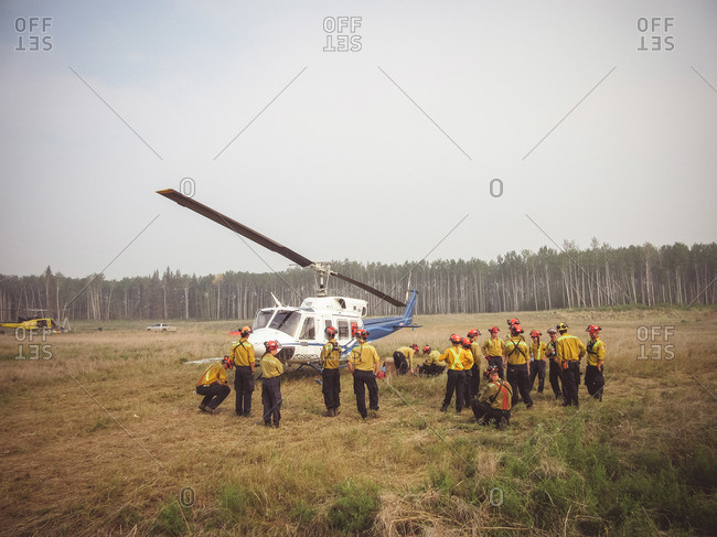Alberta, British Colombia, Canada - July 12, 2015: Panorama Crew Services members loading up helicopter, Alberta, British Colombia, Canada