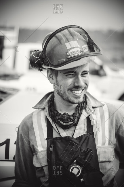 Alberta, British Colombia, Canada - July 12, 2015: Black and white portrait of Panorama Crew Services member smiling, Alberta, British Colombia, Canada
